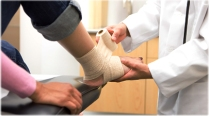 getty_rf_photo_of_doctor_tying_bandage_patient